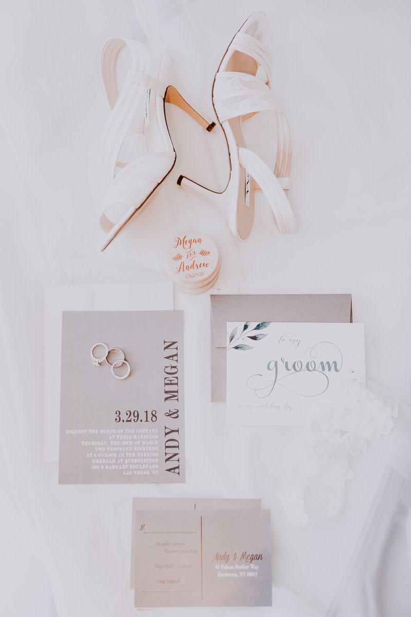 Lake Tahoe wedding photos the bride's accessories are displayed alongside her wedding invite