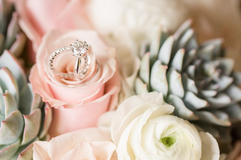 Wedding rings in bouquet photo