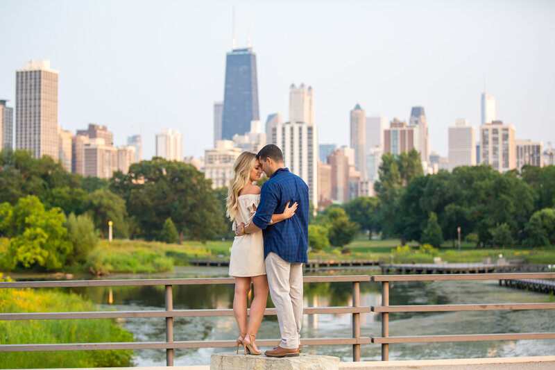 Modern engagement pose at a bridge overlooking downtown Chicago.