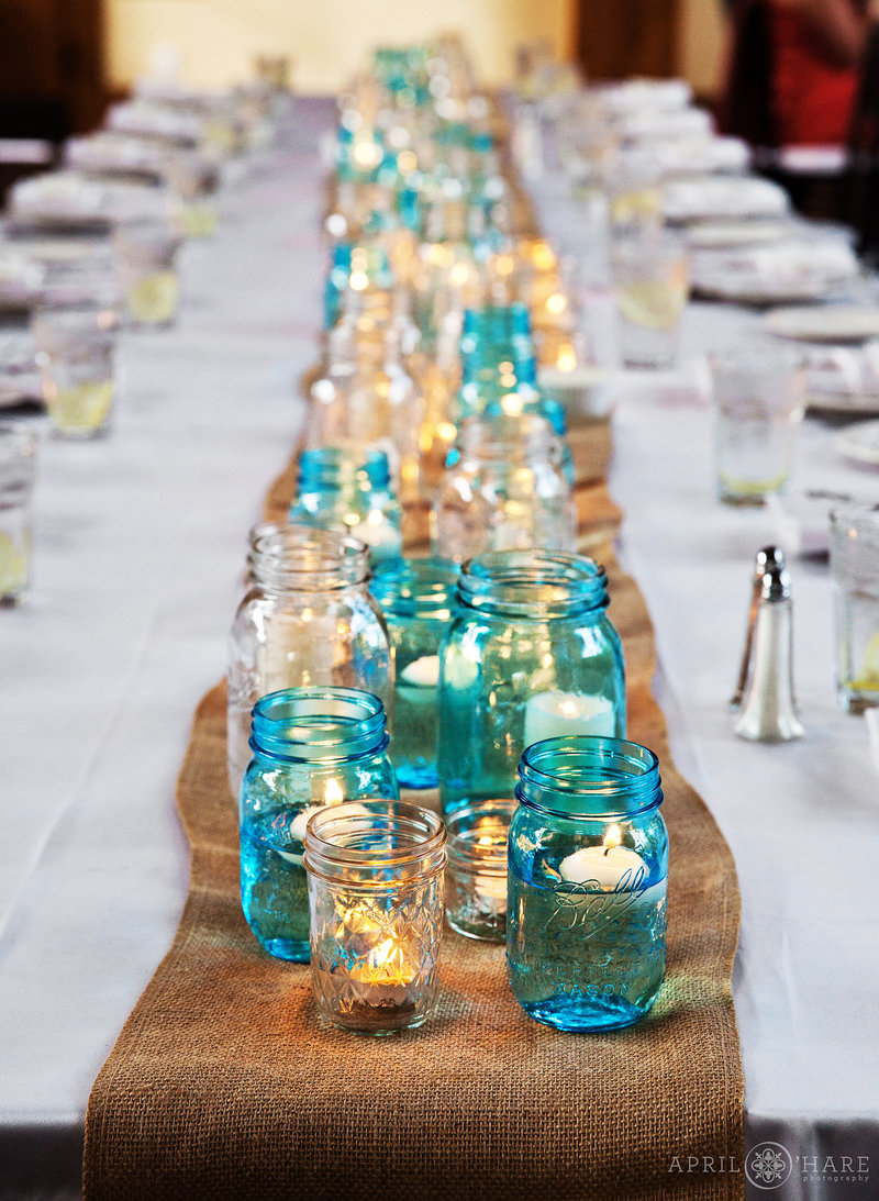 Blue-and-White-Mason-Jars-with-Floating-Candles-on-Burlap-from-a-Cowbou-Gourmet-Catering-and-Events-in-Vail-Colorado