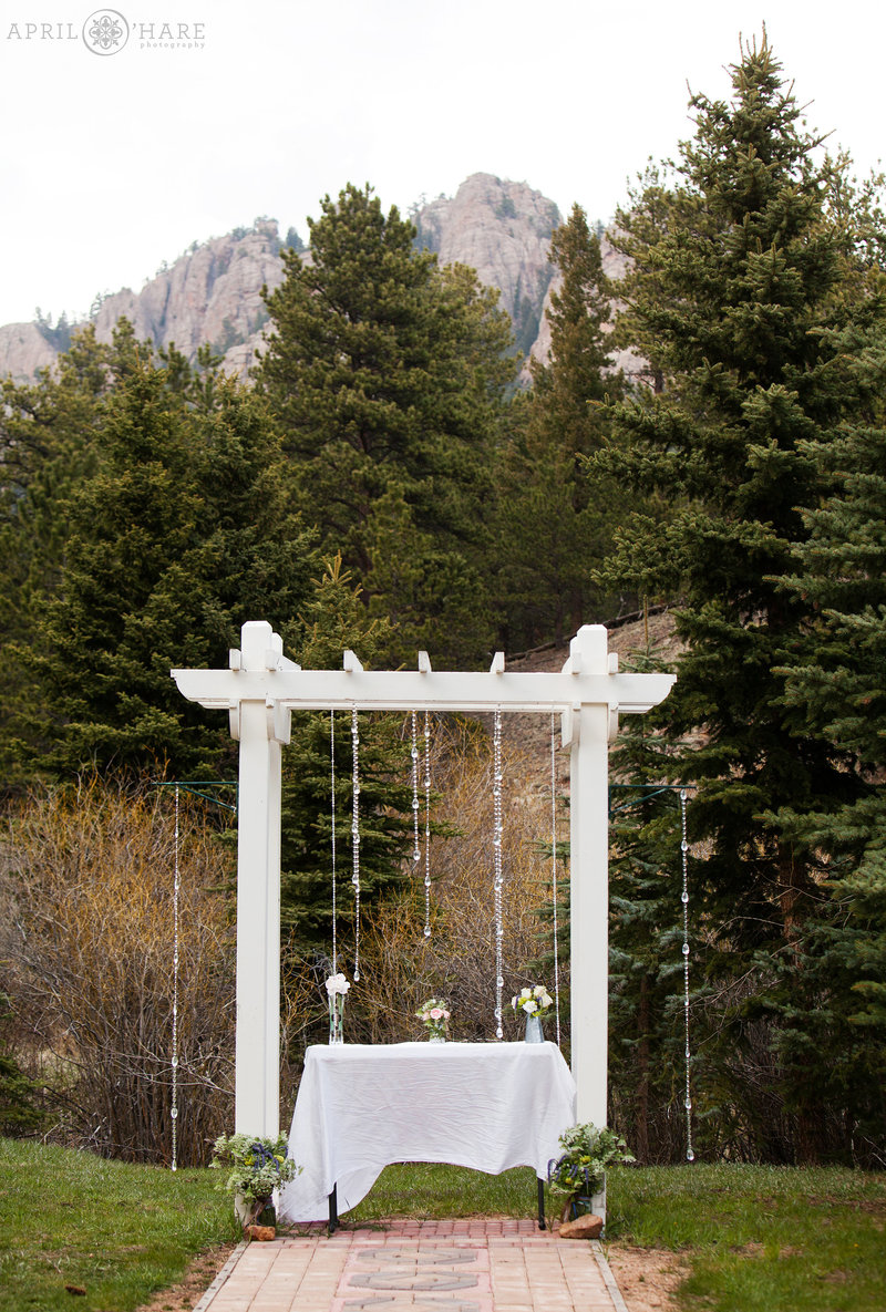 Table decor set up at Mountain View Ranch Wedding Ceremony in a mountain field