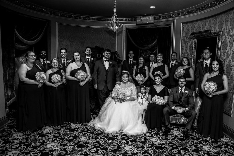 Portrait of bridal party in the lobby of the Warner Theatre