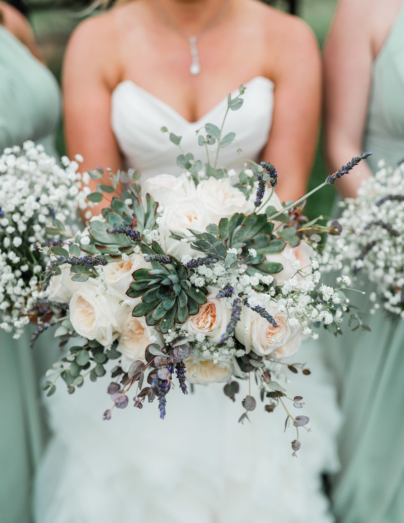 bride and bridesmaids with succulent bouquets