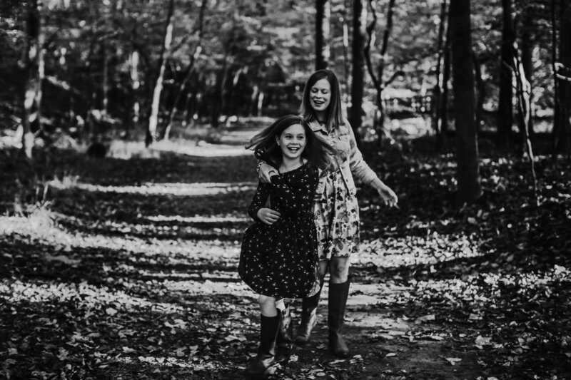 Mom and daughter dancing in the woods at Wolf Trap Park