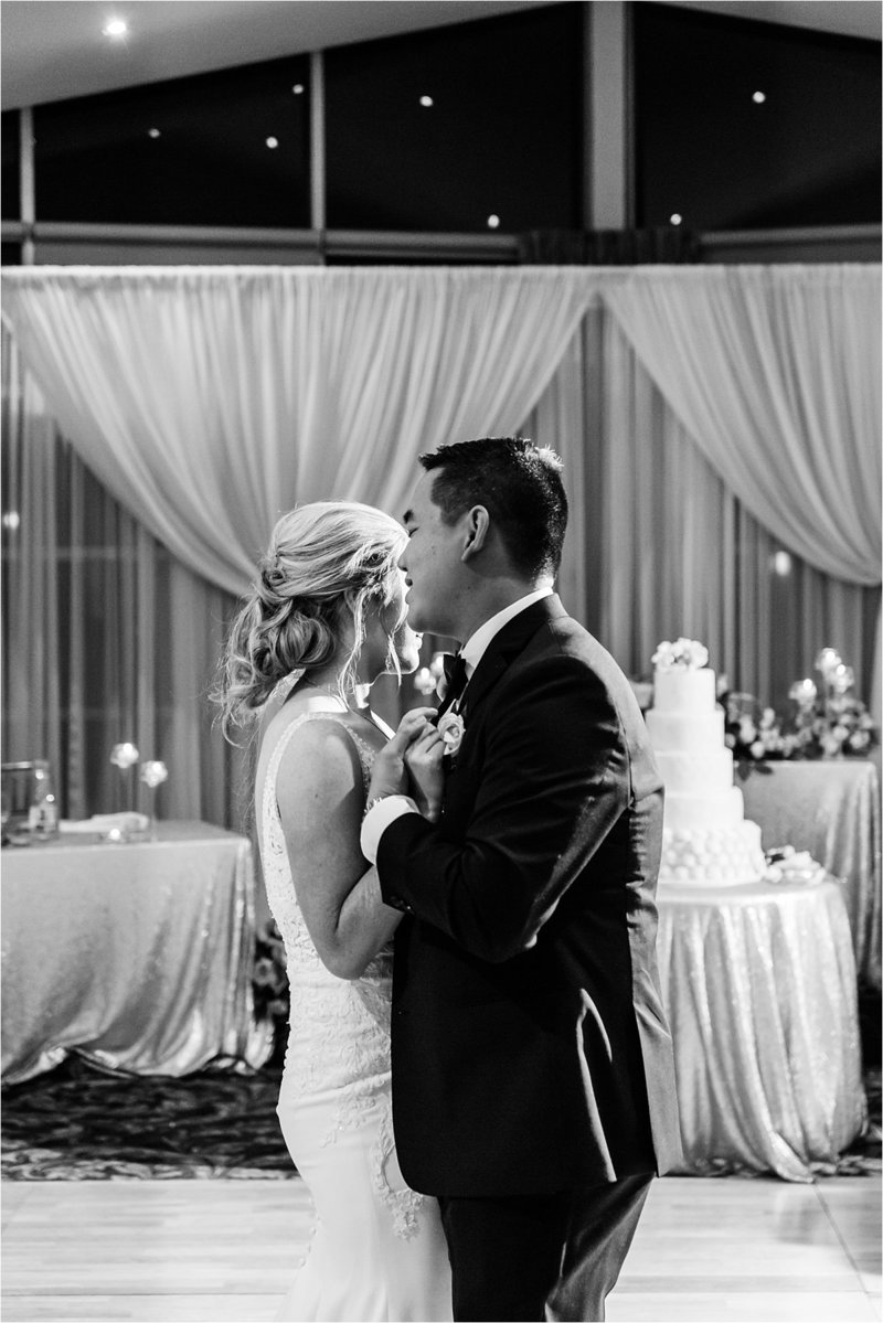Groom sings softly to his bride during their first dance at Lionhead Golf Club in Oakville