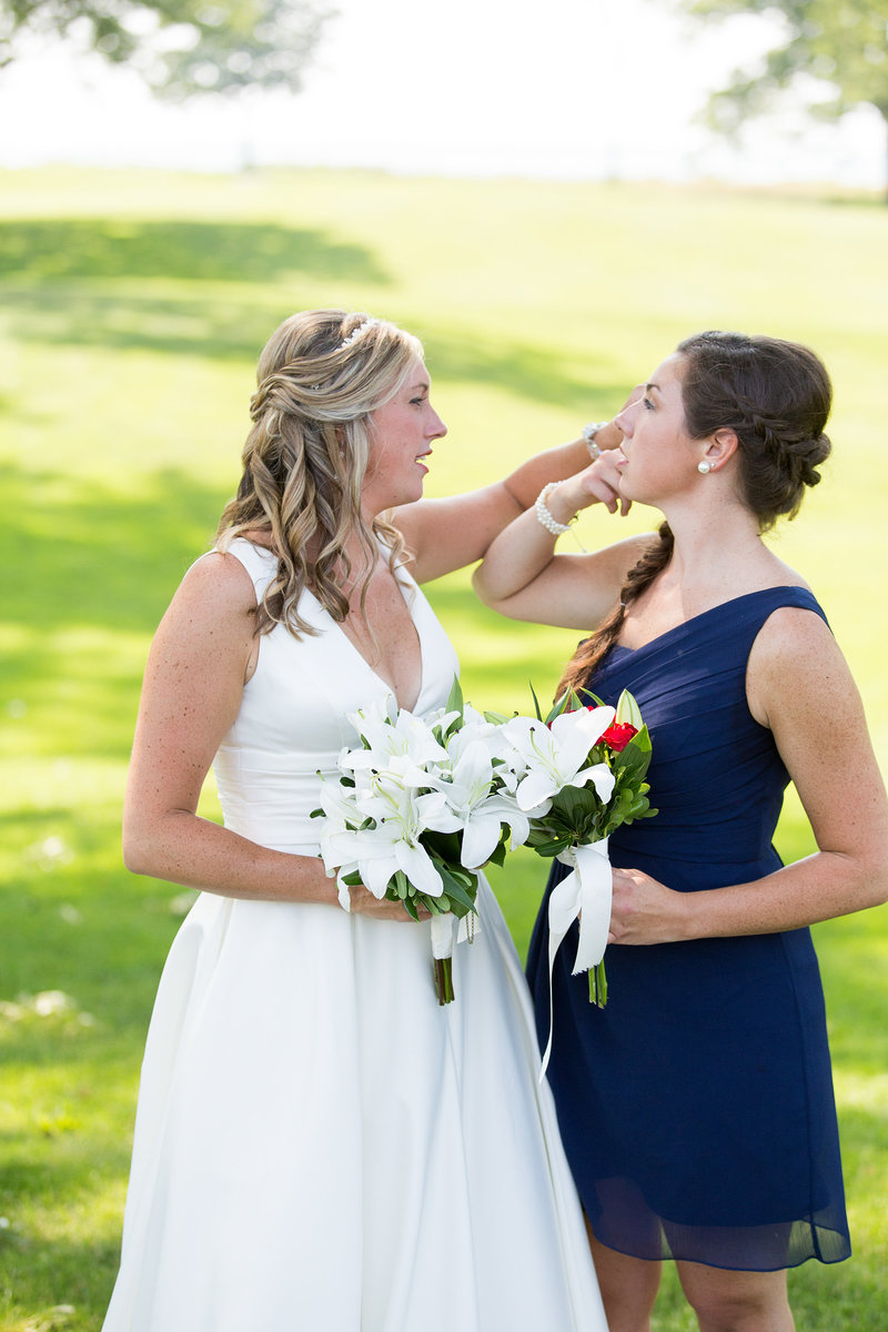 Bride with her maid of honor at Lawrence Park golf club
