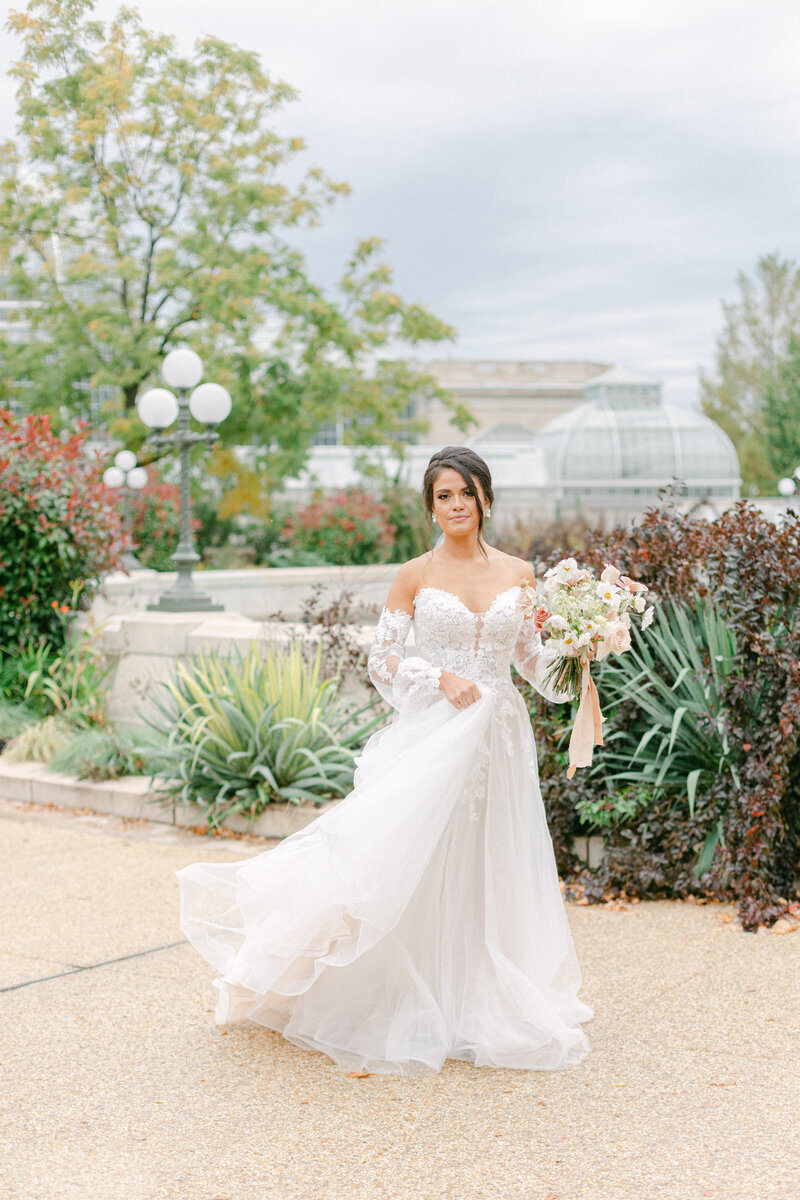 bride walking by botonical garden fountain at Washington DC Romantic Classic Wedding at the Lincoln Memorial by Costola Photography