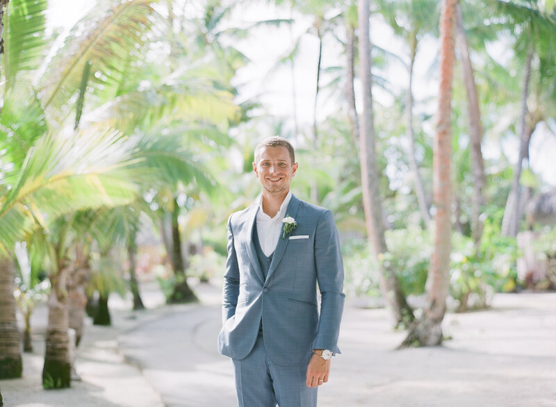 Groom portrait under the palm