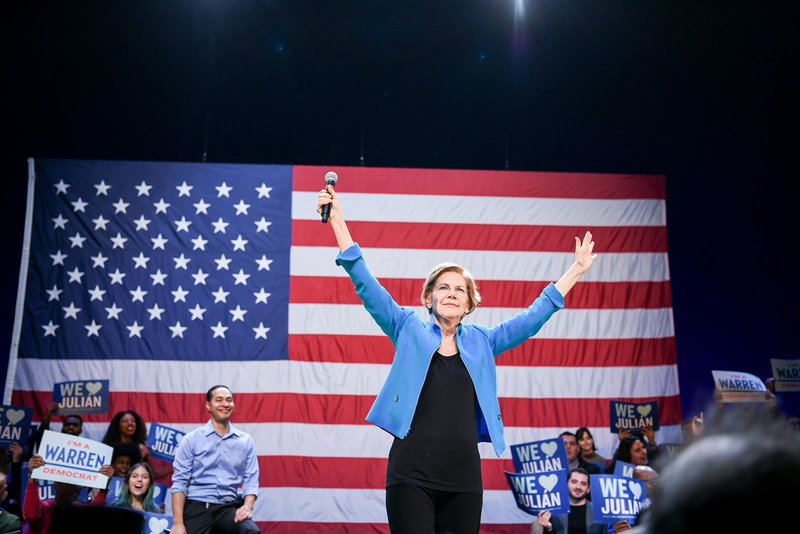 Elizabeth Warren 2020 democratic presidential primary in front of American Flag