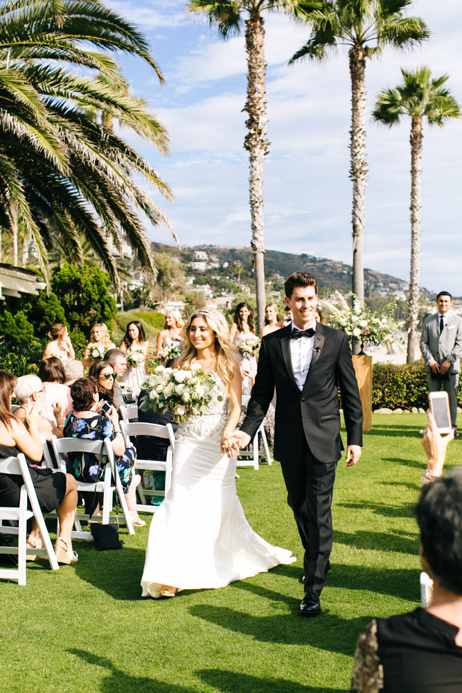 just married bride and groom walking down the aisle at teh montage resort and spa in laguna beach