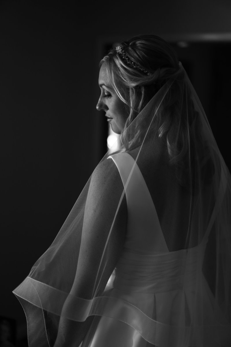 Solo portrait of bride in her dressing room before her St. Patrick's Church wedding in Erie, PA