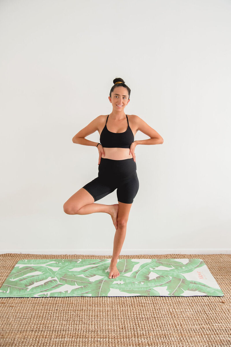 Tree pose on yoga mat