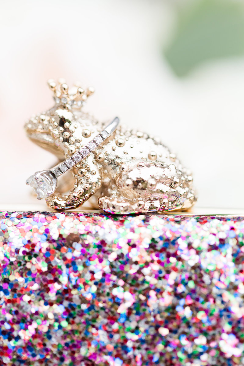 Kate-Spade-glitter-frog-prince-clutch-Bridal-detail-ring-shot-JDMP-5