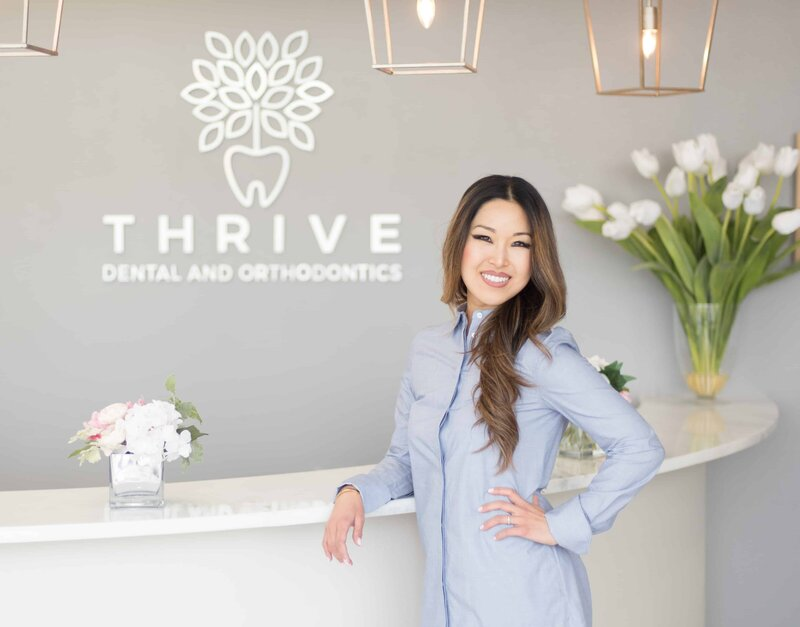 Cosmetic Dentist Christine Coughlin Posing at Thrive Dental