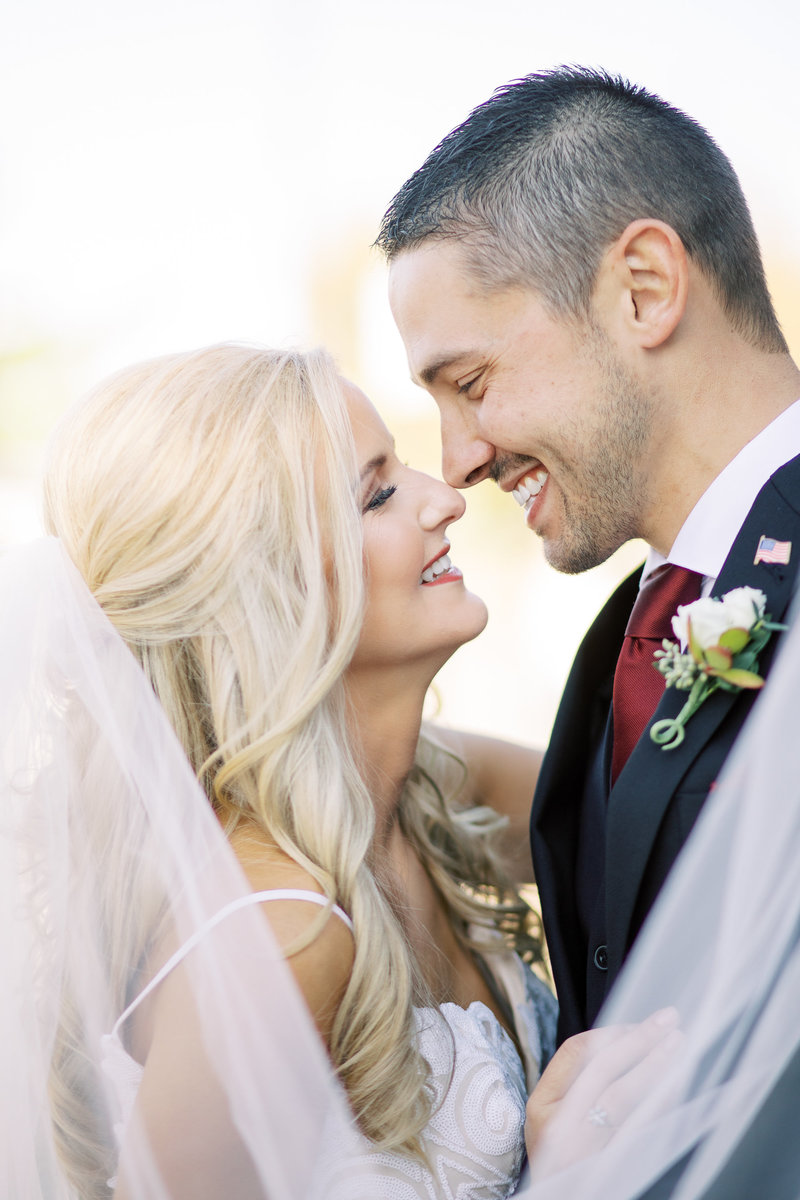 Romantic close up portrait of a bride and groom nose to nose in Cincinnati