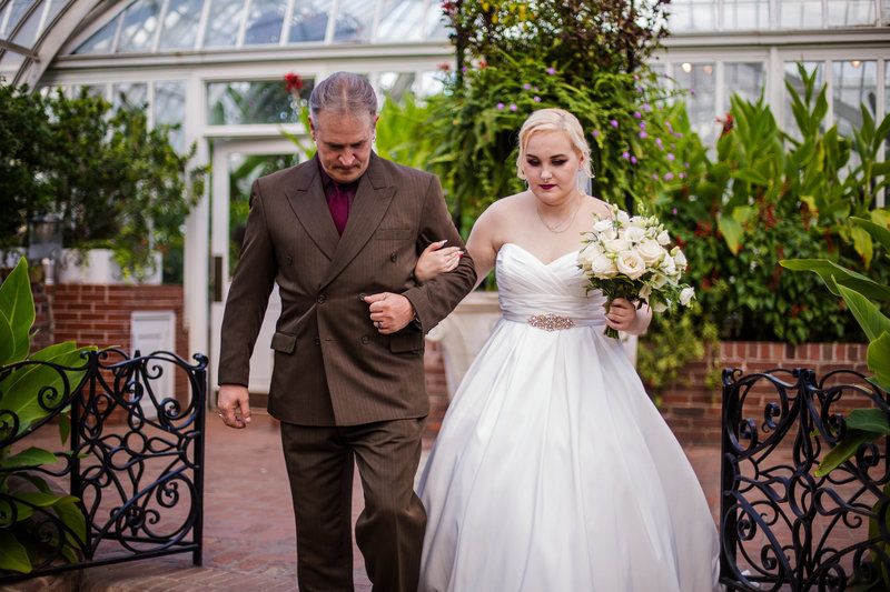 Bride escorted by her father at Phipps Conservatory wedding