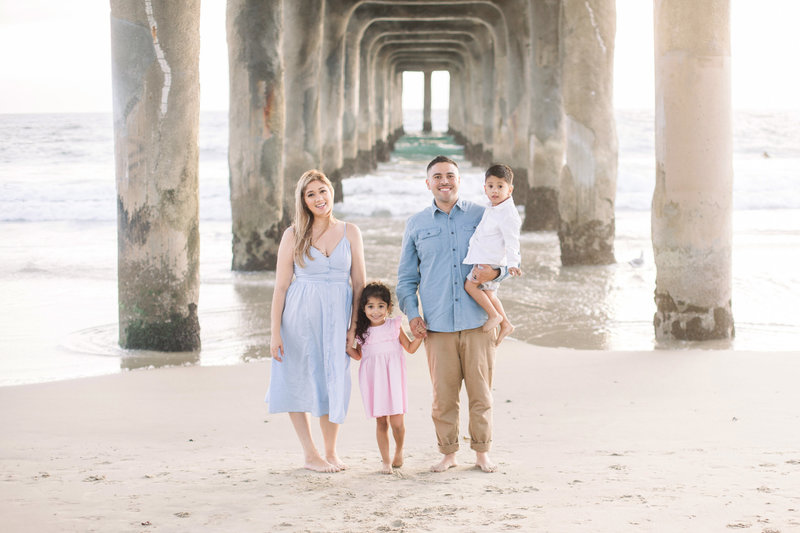 Family of 4 under the pier