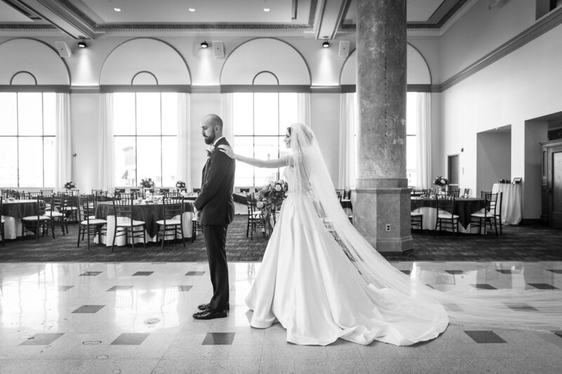 bride and groom first look at cityflats ballroom port huron