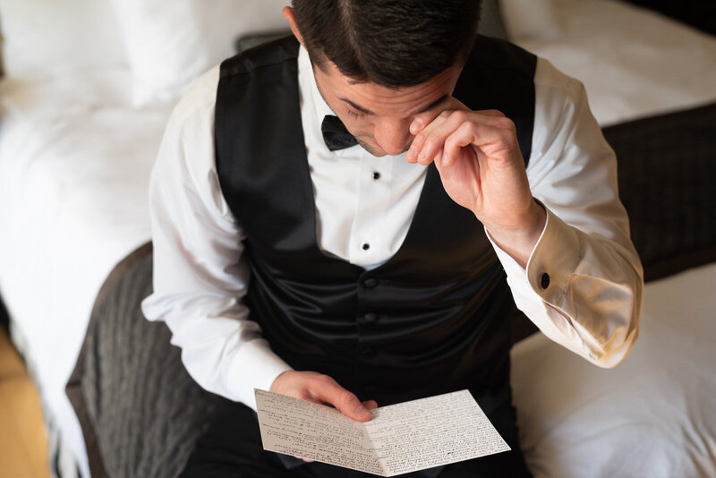 groom-letter-reading-crying-white-quill-creative