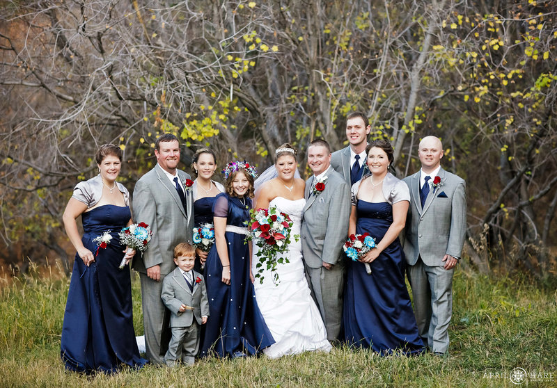 Wedding party portrait in late fall with just a little bit of color left at Pines at Genesee
