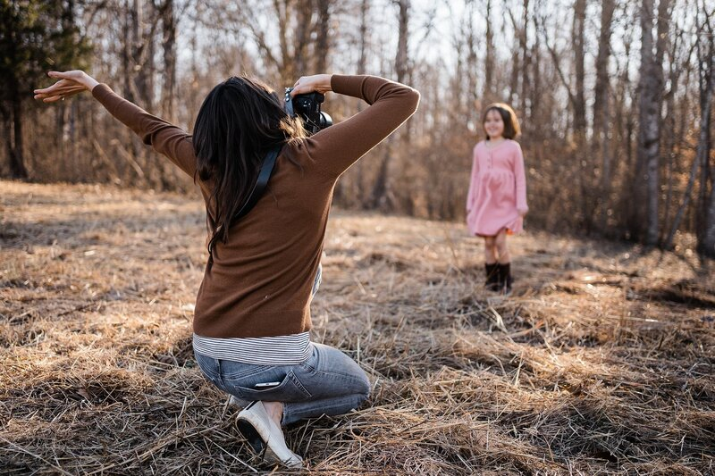 photographer celebrating while photographing a child