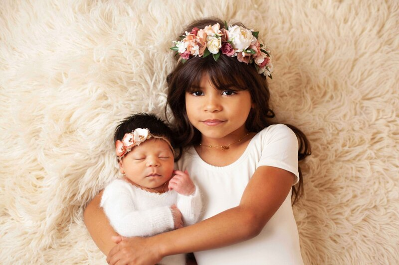 sibling newborn in cream and flower headbands