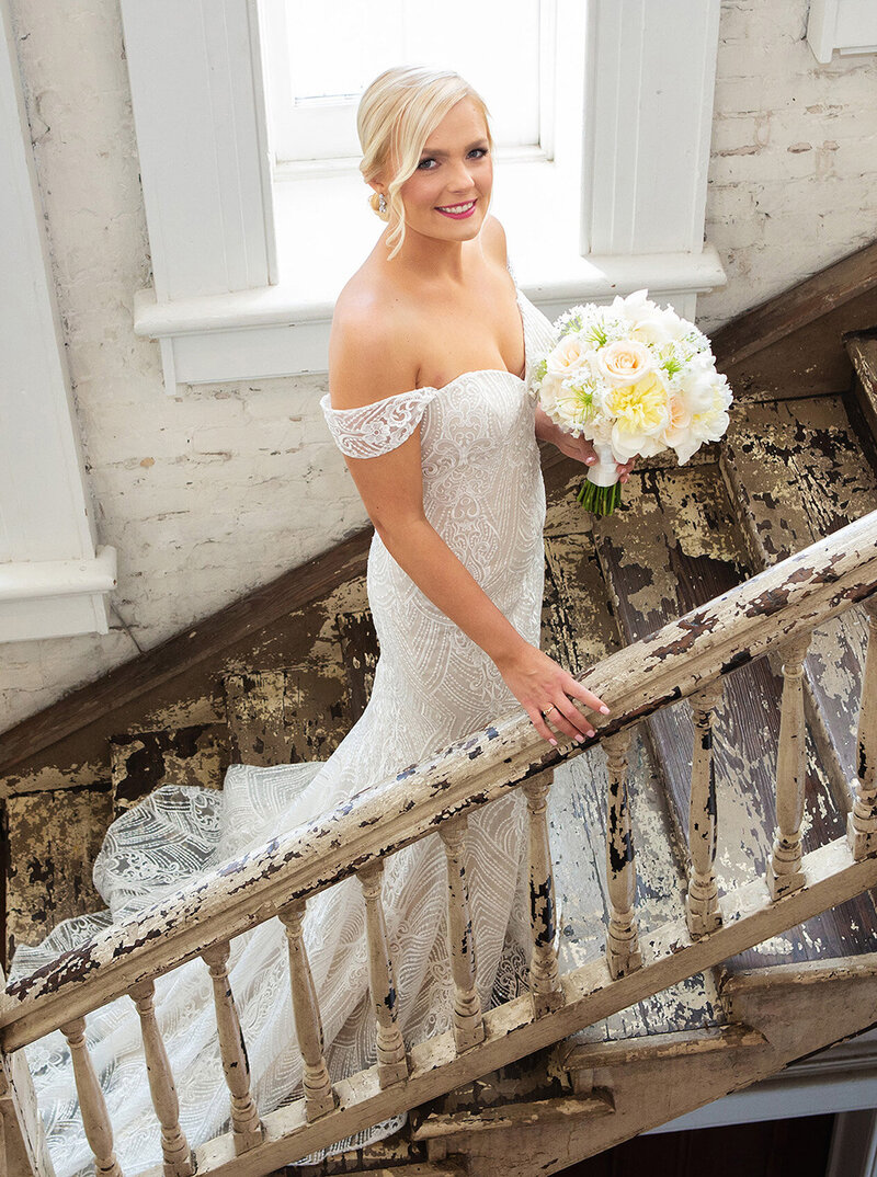 bride on the stairs of Felicity Church in New Orleans