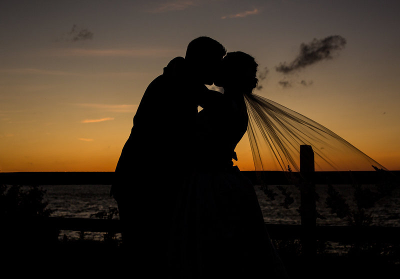 Silouette of couple kissing at sunset at Lawrence Park Golf Club