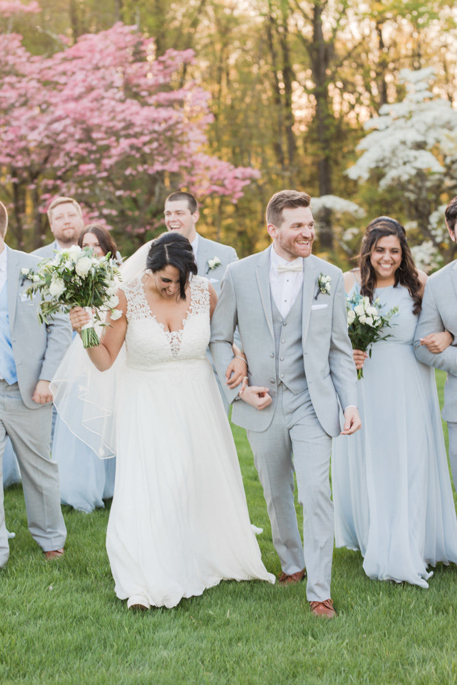 wedding party laughing  at Stone House at Stirling Ridge Maryland Wedding by  Costola Photography
