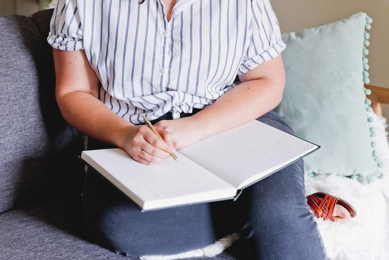AnnaKate Auten sketching on notebook