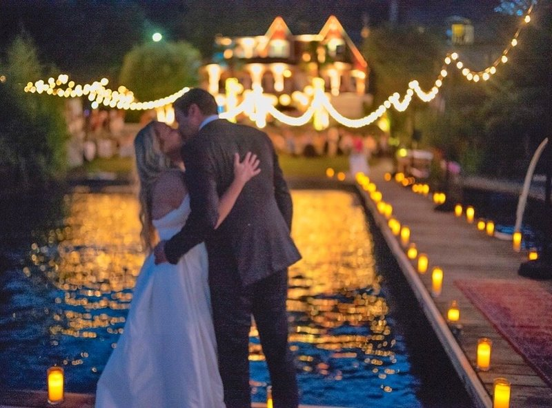 Emily John Wedding - Closer Kiss on Dock at Night House with Lights