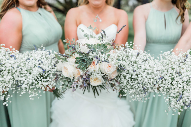 bride with bridesmaids and succulent and baby's breath bouquets