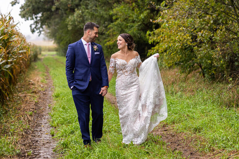 A down home, midwest wedding on the farm was the plan but mother nature decided to rain on her parade.  These two never stopped smiling regardless and we had a wonderful day with the two of these beautiful souls.