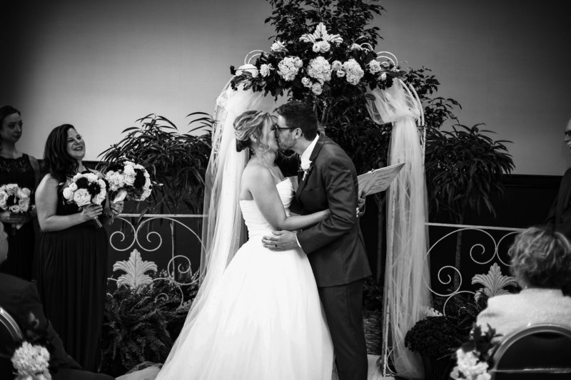 First kiss at a Sheraton Erie Bayfront Hotel wedding