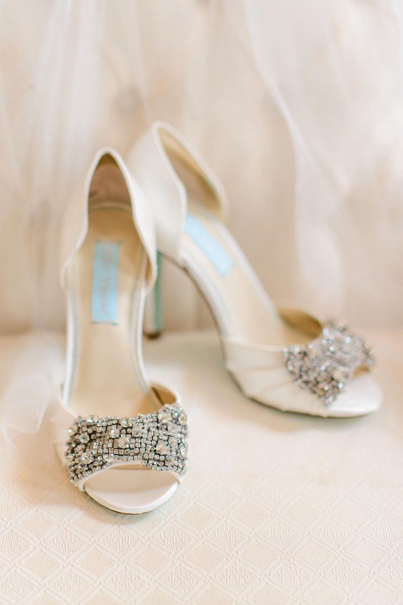 A pair of jeweled betsey johnson wedding shoes
