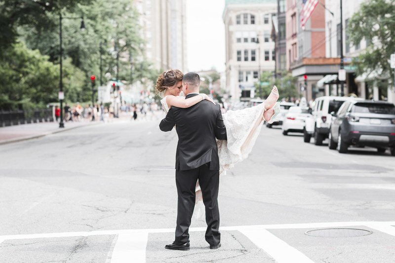 Groom holding Bride in the middle of the Boston street