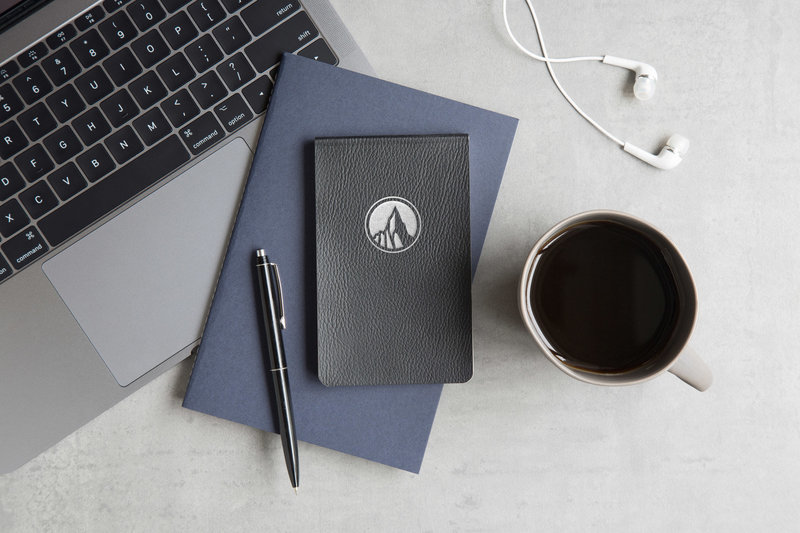 Summit-Investment-Logo-On-Leather-Book