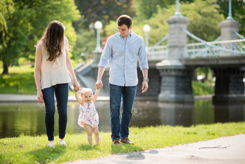 family holding hands in  Boston public gardens