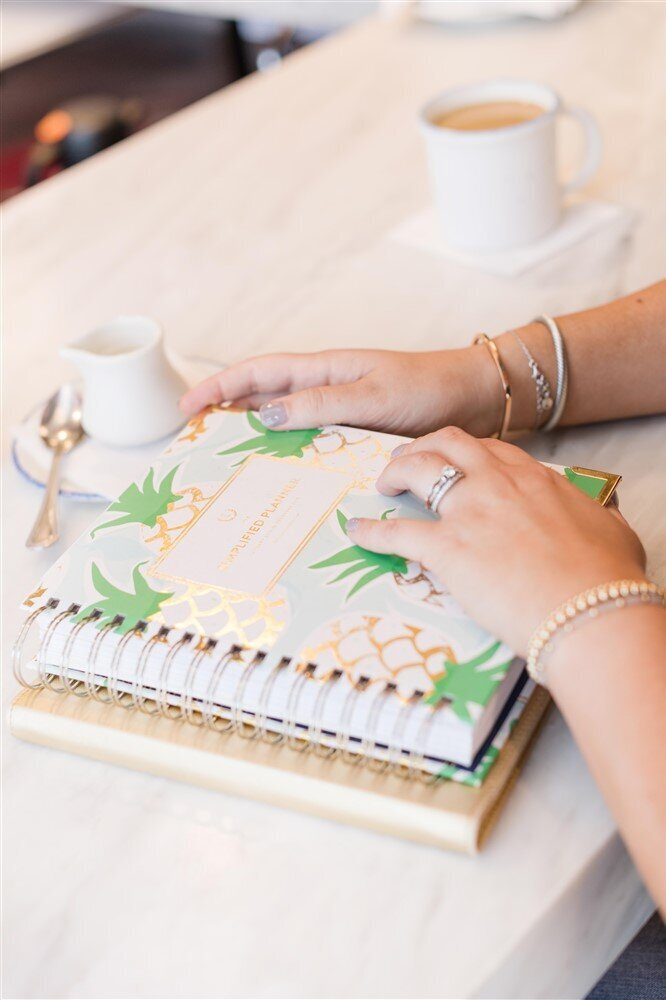 Woman's hands on a planner