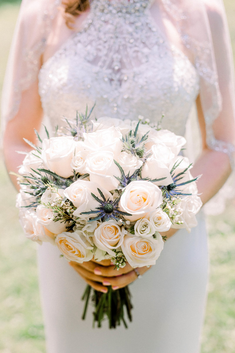 Bride holding Wedding bouquet full of roses