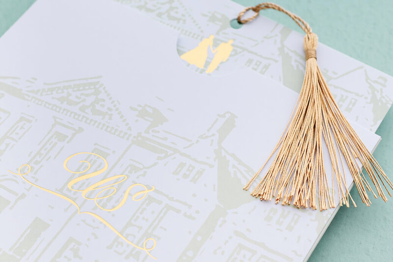 Close up of a beautiful invitation with a gold tassel