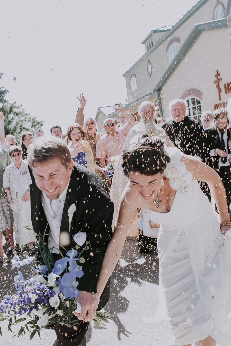 Lake Tahoe wedding pictures a bride and groom dodge bird seed raining down from guests