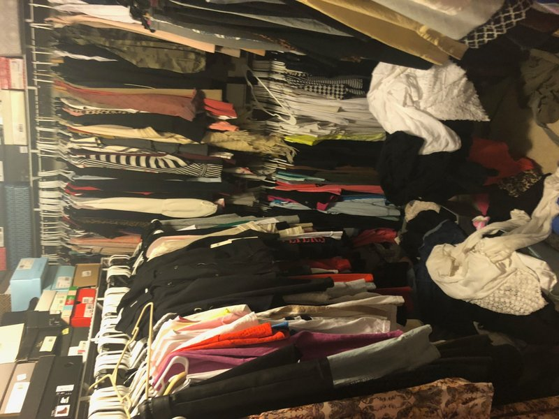 Closet Stuffed with Clothing