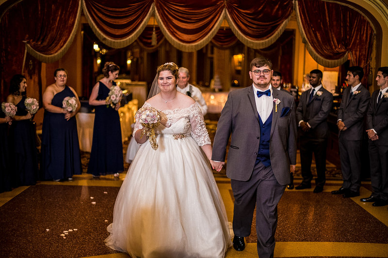 Recessional photo of bride and groom at the end of Warner Theatre wedding ceremony