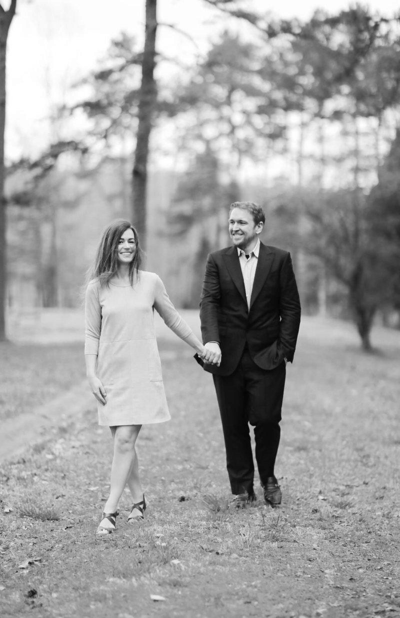 A Greensboro wedding and engagement photographer captures a trendy couple posing for their engagement session.