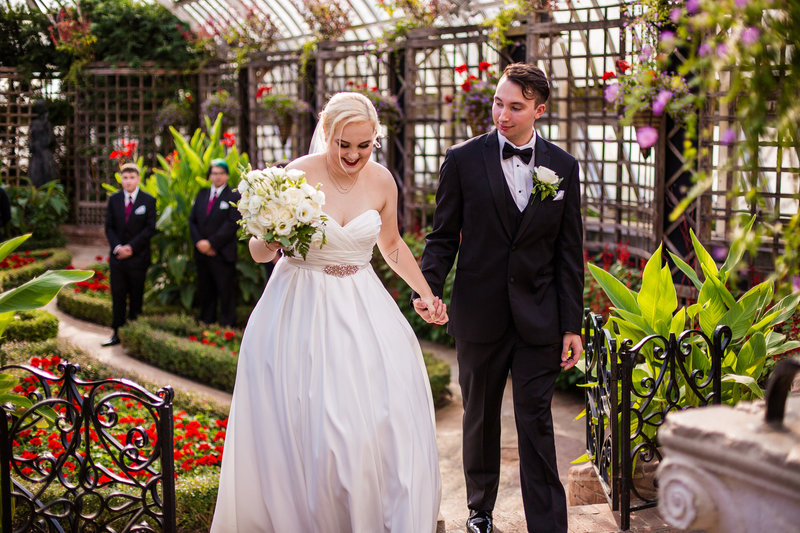 Recessional portrait of bride and groom at the end of their Phipps Conservatory wedding