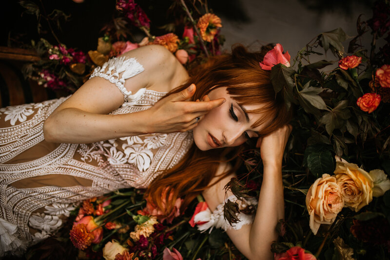 bride laying on roses