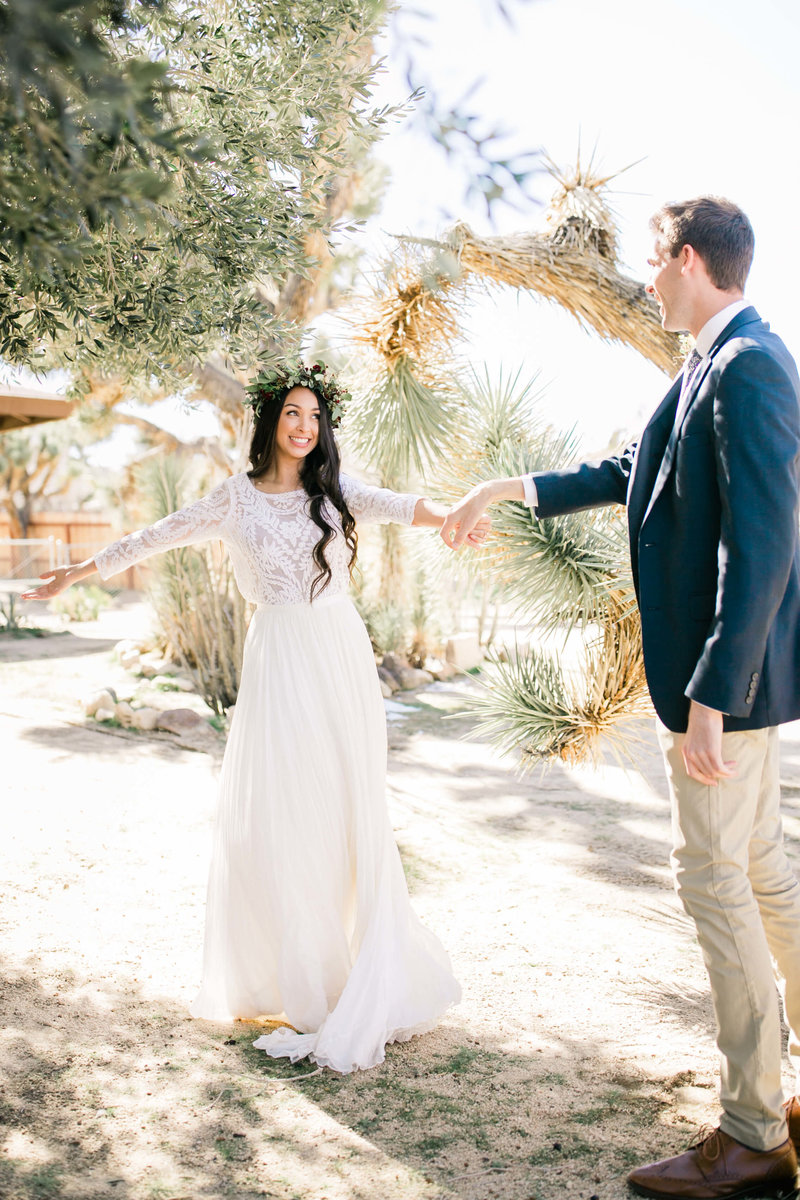 the happy bride and groom share a first look before their joshua tree adventure wedding