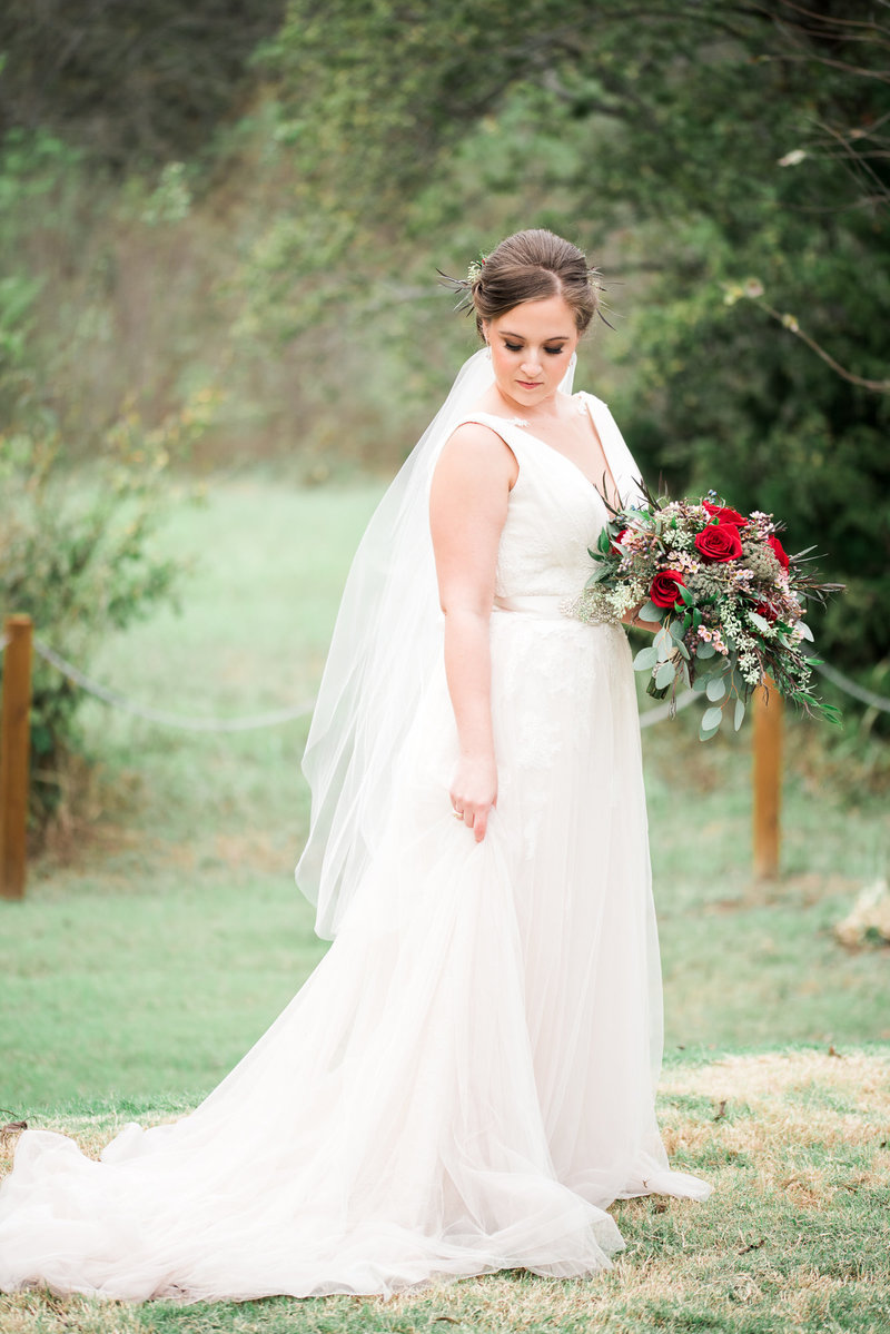 Bride in field at La Cour Dallas Wedding Venue