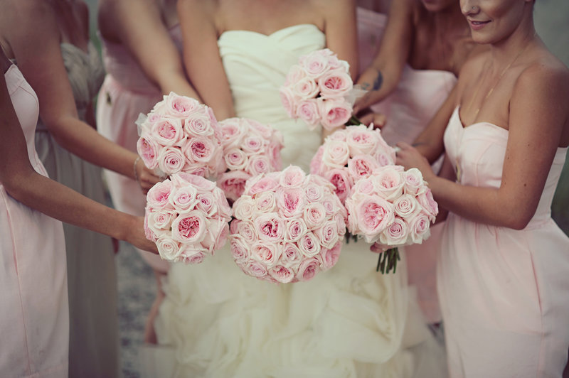 Bridesmaids in pink with pink roses for a Calgary wedding